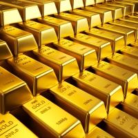 Prețul aurului: tumultoasa creștere, decădere și estimările pentru 2015